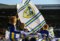 Young Leeds United fans wave flags before the match<br /> <br /> Photographer Alex Dodd/CameraSport<br /> <br /> The EFL Sky Bet Championship - Leeds United v Bolton Wanderers - Saturday 23rd February 2019 - Elland Road - Leeds<br /> <br /> World Copyright © 2019 CameraSport. All rights reserved. 43 Linden Ave. Countesthorpe. Leicester. England. LE8 5PG - Tel: +44 (0) 116 277 4147 - admin@camerasport.com - www.camerasport.com