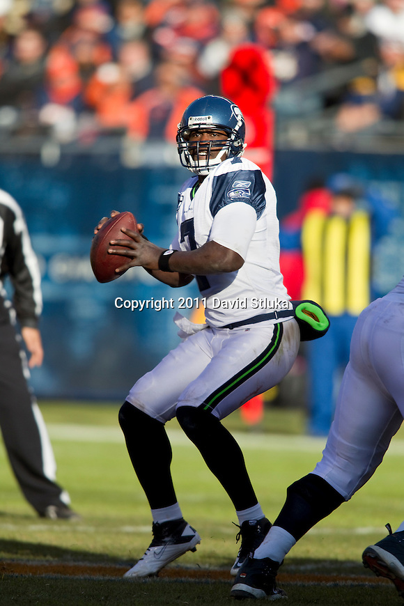 Seattle Seahawks quarterback Tarvaris Jackson (7) throws a pass during a week 15 NFL football game against the Chicago Bears on December 18, 2011 in Chicago. The Seahawks won 38-14. (AP Photo/David Stluka)
