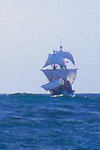 The Golden Hind, Sir Francis Drakes historic sailing ship replica under full sail, off the US west coast at sunrise, commemorating Drake's around the world (1577-1580) Voyage of Discovery, property released,.