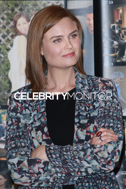 CENTURY CITY, CA, USA - NOVEMBER 14: Emily Deschanel poses at FOX's 'Bones' 200th Episode Celebration With The Cast And Producers held at the Fox Studio Lot on November 14, 2014 in Century City, California, United States. (Photo by David Acosta/Celebrity Monitor)