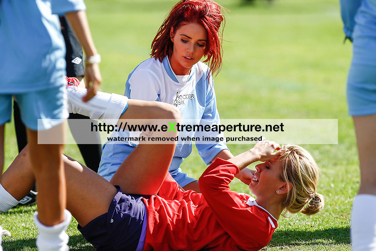 London, UK on Sunday 31st August, 2014. Amy Childs shows concern for her friend Rachel Riley after she hurt her knee during the Soccer Six charity celebrity football tournament at Mile End Stadium, London.