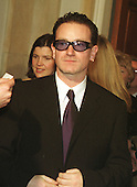 Bono, lead singer of the rock group U2,  waits to be announced to United States President Bill Clinton at the Millennium celebration at the White House in Washington, D.C. on December 31, 1999..Credit: Ron Sachs / CNP