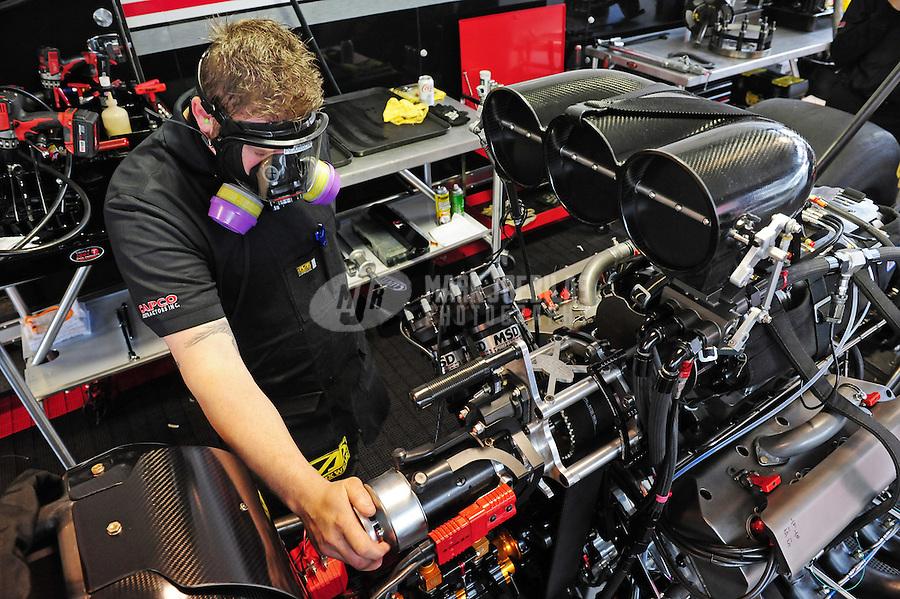 Feb. 12, 2012; Pomona, CA, USA; NHRA crew members for top fuel dragster driver Steve Torrence during the Winternationals at Auto Club Raceway at Pomona. Mandatory Credit: Mark J. Rebilas-