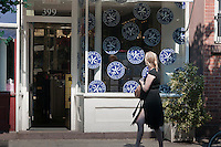 Upscale retail stores and businesses, including Bond No. 9 parfumers, on  Bleecker Street in Greenwich Village in New York on Friday, June 29, 2012. (© Richard B. Levine)