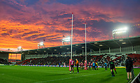 Picture by Allan McKenzie/SWpix.com - 06/04/2018 - Rugby League - Betfred Super League - St Helens v Hull FC - The Totally Wicked Stadium, Langtree Park, St Helens, England - St Helens's Danny Richardson kicks a conversion against Hull FC under a dramatic sunset.