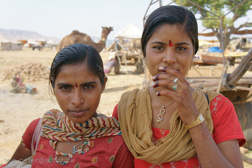 two women visiting camel fair in Pushkar, Rajastan, India