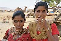 two women visiting camel fair in Pushkar, Rajastan, India