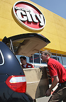 Members of the Circuit City product flow team Nick Misevski, left, of Columbus, and Bill Sheppard, of Delaware, load furniture into a customer's van Monday, June 20, 2007 in Columbus, Ohio.