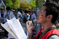 An organiser radies the parade during Tokyo Rainbow Pride festival, Yoyogi Park, Tokyo, Japan. Sunday April 27th 2014 This was the third year this annual gay-pride event has been held in Japan capital.with food, fashion and health care stalls and musical performances set up in Yoyogi Park event square and a colourful parade around Shibuya at 1pm.