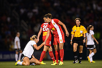 Western New York Flash midfielder Carli Lloyd (10) helps up Portland Thorns midfielder Allie Long (10). The Portland Thorns defeated the Western New York Flash 2-0 during the National Women's Soccer League (NWSL) finals at Sahlen's Stadium in Rochester, NY, on August 31, 2013.
