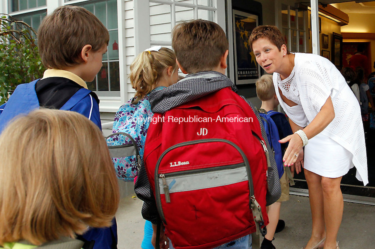 Roxbury, CT-28 August 2012-082812CM02-  Cathy Colella (right), Principal at Booth Free Elementary School greets students on their first day of school Tuesday morning in Roxbury.  Christopher Massa Republican-American