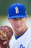 Burlington Royals relief pitcher Ian Tompkins (23) poses with a teammates right-handed glove during the game against the Johnson City Cardinals at Burlington Athletic Park on July 14, 2014 in Burlington, North Carolina.  The Cardinals defeated the Royals 9-4.  (Brian Westerholt/Four Seam Images)