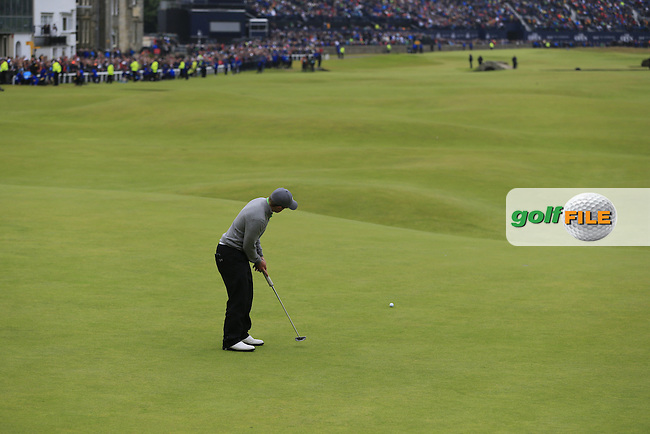 Paul DUNNE (AM)(IRL) putts on the 18th green during Monday's Final Round of the 144th Open Championship, St Andrews Old Course, St Andrews, Fife, Scotland. 20/07/2015.<br /> Picture Eoin Clarke, www.golffile.ie
