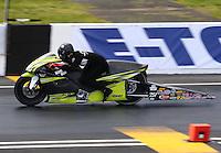 May 31, 2014; Englishtown, NJ, USA; NHRA pro stock motorcycle rider Steve Johnson during qualifying for the Summernationals at Raceway Park. Mandatory Credit: Mark J. Rebilas-