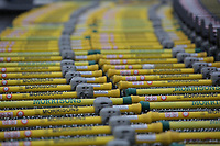 Shopping trolleys' handlebars and coin receivers at a Morrisons super market