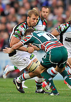 Leicester, England. Sam Harrison of Leicester Tigers tackles Chris Robshaw (Captain) of Harlequins during the Aviva Premiership match between Leicester Tigers and Harlequins at Welford Road on September 22, 2012 in Leicester, England.