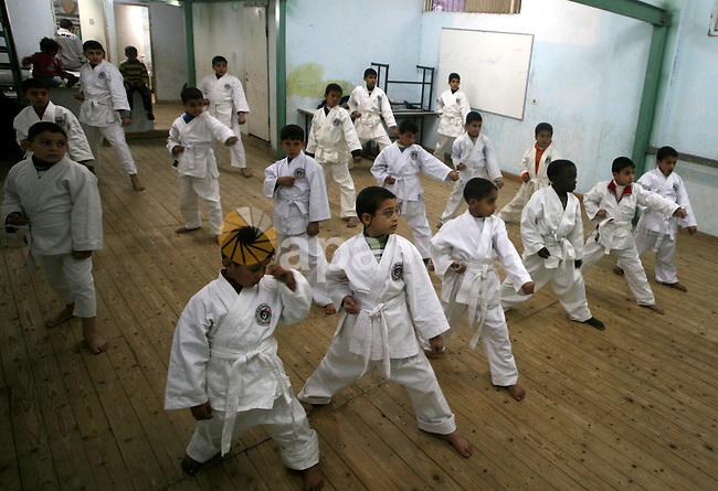 Palestinian children attend a karate lesson in the al-Walid Karate School in the southern Gaza Strip in town of Rafah on January 25, 2010. Palestinian teachers Ahmed Issa and Khaled Sheikh Eid teach some 20 children in the school. Photo by Abed Rahim Khatib