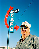 USA, New Mexico, truck driver standing under Grants Cafe sign, Grants