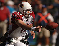 Sep 25, 2005; Seattle, WA, USA; Arizona Cardinals quarterback #13 Kurt Warner tosses the ball while being pressured by the Seattle Seahawks defense in the second quarter at Qwest Field. Mandatory Credit: Photo By Mark J. Rebilas