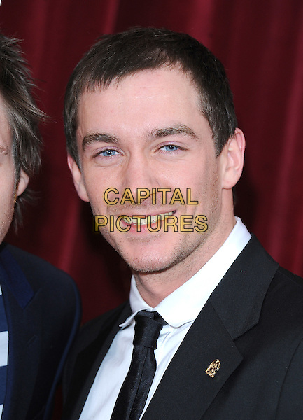 ANTHONY QUINLAN.The British Soap Awards 2010, London Television Centre, London, England..8th May 2010.arrivals headshot portrait black white.CAP/BEL.©Tom Belcher/Capital Pictures.