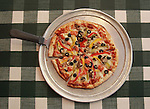 Veggie pizza with a five-cheese blend.  The pizzas are hand-tossed, but making the pizza does not begin until after the customer orders it.  The Amore' Italian Ristorante is located at 1050 Eastgate Drive in O'Fallon.