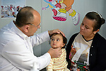 Pediatrician Bassam Nayem Abo examines a young patient in a clinic for internally displaced people in Ankawa, near Erbil, Iraq. The clinic is run by the Dominican Sisters of St. Catherine of Siena, who were themselves displaced by ISIS in 2014.