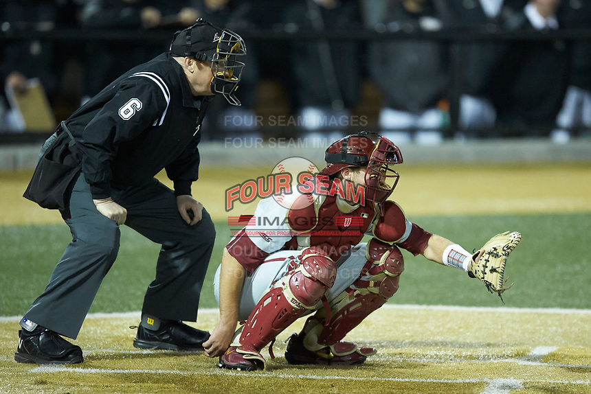 Florida State Seminoles catcher Cal Raleigh (35) sets a target as home plate umpire Frank Sylvester looks on during the game against the Wake Forest Demon Deacons at David F. Couch Ballpark on March 9, 2018 in  Winston-Salem, North Carolina.  The Seminoles defeated the Demon Deacons 7-3.  (Brian Westerholt/Four Seam Images)