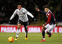 Calcio, Serie A:  Bologna vs Juventus. Bologna, stadio Renato Dall'Ara, 19 febbraio 2016. <br /> Juventus&rsquo; Juan Cuadrado, left, is challenged by Bologna's Saphir Taider during the Italian Serie A football match between Bologna and Juventus at Bologna's Renato Dall'Ara stadium, 19 February 2016.<br /> UPDATE IMAGES PRESS/Isabella Bonotto