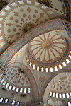 The interior tiled domes of the Blue Mosque in Istanbnul