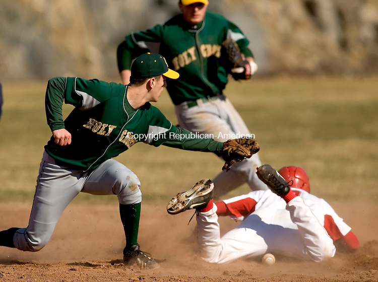 WOLCOTT, CT--09 APRIL 2007--040907JS05-Wolcott's Anthony Guerrera steals second as Holy Cross' Tim Brady looses the ball during their game against Monday at the BAW complex in Wolcott.<br /> Jim Shannon / Republican-American