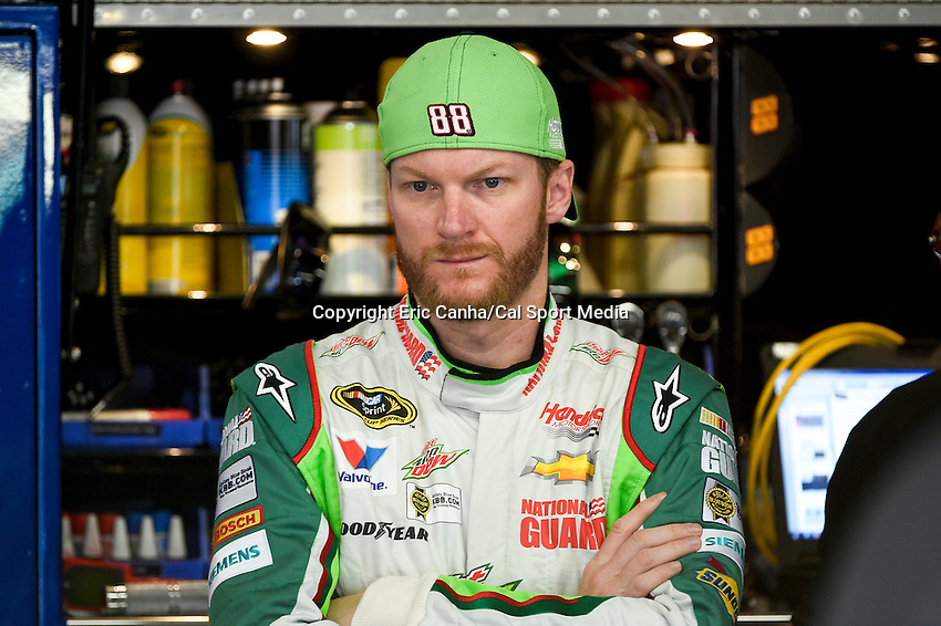 September 19, 2014 - Loudon, New Hampshire, U.S. -  Sprint Cup Series driver Dale Earnhardt Jr. (88) waits in the garage for his car to be prepared for a practice session of the NASCAR Sprint Cup Series Sylvania 300 held at the New Hampshire Motor Speedway in Loudon, New Hampshire.   Eric Canha/CSM
