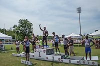 John Burroughs senior Ezekiel Elliott stands atop the awards podium and waves to the stands after winning the Class 3 200-meter dash title, his fourth title in 2 hours and 35 minutes at the 2013 Missouri High School State Track and Field Championships. Elliott claimed the 110-meter hurdles, 100-meter dash, 300-meter hurdles, and 200-meter dash, earning 40 team points of the Bombers 55.5 points for second-place, just 2.5 points behind champion Grandview. The performance and season Elliott had earned him the Gatorade Missouri Track and Field Athlete of the Year honor.