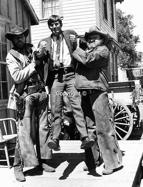 Photojournalist Ron Bennett on Hollywood western movie set,