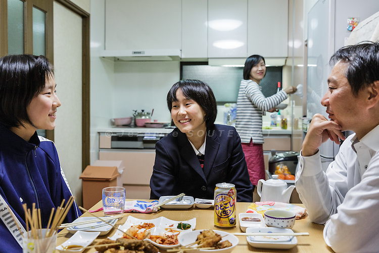 Osaka, Japan, November 25 2016 - At home with the RI&rsquo;s, a family of 4 &laquo;&nbsp;zainichi&nbsp;&raquo; residing in Japan for 3 generations. Mr RI is member of the local Chosen Soren (General Association of Korean Residents in Japan with close ties to North Korea) and his wife is doing some consultant work. Both used to work as teachers at Korean schools. Their 2 daughters attend Korean schools (middle school and high school). The 4 of them speak japanese at home.<br /> 140 Korean schools are operated in Japan, including kindergartens and one university. The schools were initially funded by North Korea, but this money has dried up and the Japanese government has refused the Chosen Soren&rsquo;s requests that it fund Korean schools.<br /> Professors at East-Osaka Korean middle school have not been paid for months.<br /> The majority of Koreans in Japan are Zainichi Koreans, often known simply as Zainichi , who are the permanent ethnic Korean residents of Japan. The term &quot;Zainichi Korean&quot; refers only to long-term Korean residents of Japan who trace their roots to Korea under Japanese rule, distinguishing them from the later wave of Korean migrants who came mostly in the 1980s. The estimated population is about 500,000 people. As of 2016, about 90% of them have South Korean nationality and 10% of them are considered by Japanese administration as &laquo;&nbsp;Korean&nbsp;&raquo; (chosenjin), the word used for korean people before the division between North and South Korea in 1948. The ratio used to be the opposite in the 1950ies.