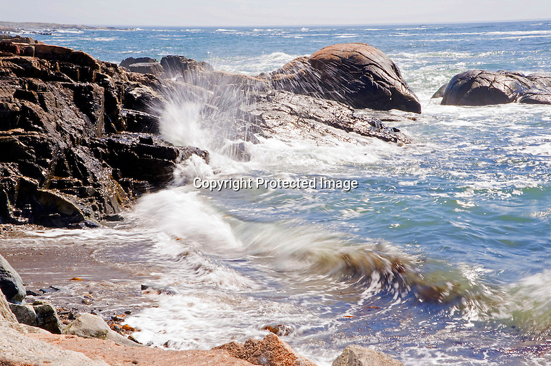 Ocean Surf Crashing against Rocky Shore on the Coast of Maine