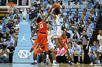 CHAPEL HILL, NC - JANUARY 11: Tevin Mack #13 of Clemson University blocks a shot by Leaky Black #1 of the University of North Carolina during a game between Clemson and North Carolina at Dean E. Smith Center on January 11, 2020 in Chapel Hill, North Carolina.