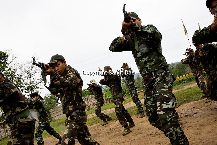 The cadres of the ceasefire group, Dima Halam Daogan (DHD) are seen in doing the daily weapon training drills at the designated camp in Basabari, outskirts of Mibang in North Cachar Hills, Assam, India. Ethnic clashes are regularly taking place between Zeme Nagas and the Dimasa tribe in North Cachar Hills.