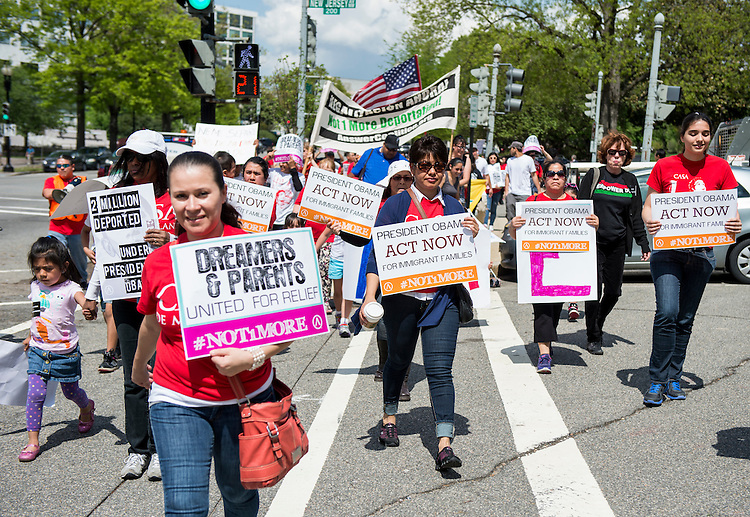 UNITED STATES - MAY 1: Immigration reform advocates march to the U.S. Capitol then on to the White House on May 1, 2014, calling on Congress and President Obama to stop deportations and pass immigration reform. (Photo By Bill Clark/CQ Roll Call)