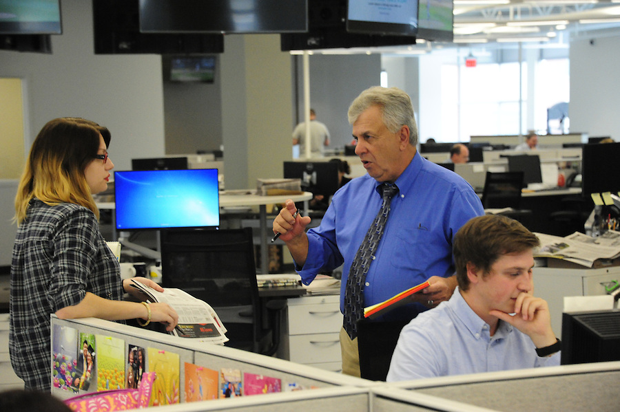 Tim Martin AME News for the Pittsburgh Post-Gazette retires September 25, 2015.<br /> <br /> Martin works with paginators Emily Dobler and Tyler Pecyna. (cq)