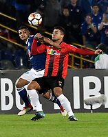 BOGOTA - COLOMBIA – 17 - 04 - 2018: Christian Huerfano (Izq.) jugador de Millonarios (COL), disputan el balon con Carlos Sierra (Der.) jugador de Deportivo Lara (VEN), durante partido entre Millonarios (COL) y Deportivo Lara (VEN), de la fase de grupos, grupo G, fecha 3 de la Copa Conmebol Libertadores 2018, en el estadio Nemesio Camacho El Campin, de la ciudad de Bogota. / Christian Huerfano (L) player of Millonarios (COL), fights for the ball with Carlos Sierra (R) player of Deportivo Lara (VEN), during a match between Millonarios (COL) and Deportivo Lara (VEN), of the group stage, group G, 3rd date for the Conmebol Copa Libertadores 2018 in the Nemesio Camacho El Campin stadium in Bogota city. VizzorImage / Luis Ramirez / Staff.