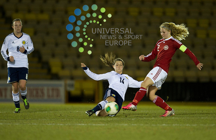 Mairead Fulton of Scotland challenges for the ball against Mie Jans of Denmark during the UEFA Women's Under-19 Championship Elite Round match between Scotland and Denmark at Almondvale Stadium, Livingston. 4 April 2013. Picture by Ian Sneddon / Universal News and Sport (Scotland). All pictures must be credited to www.universalnewsandsport.com. (Office) 0844 884 51 22. .
