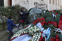 Pictured: Two young girls leave a red carnations at the monument for the uprising at the Athens Polytechnic in Athens Greece. Thursday 17 November 2016<br /> Re: 43rd anniversary of the Athens Polytechnic uprising of 1973 which was a massive demonstration of popular rejection of the Greek military junta of 1967–1974. The uprising began on November 14, 1973, escalated to an open anti-junta revolt and ended in bloodshed in the early morning of November 17 after a series of events starting with a tank crashing through the gates of the Polytechnic.