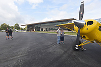 NWA Democrat-Gazette/FLIP PUTTHOFF <br />Visitors on Saturday Oct. 6 2018 look at aircraft during the grand opening of Thaden Fieldhouse at the Bentonville airport. The fieldhouse along Southwest I Street features an exhibit hangar, porches that overlook the runway, a cafe and retail shop. It is also home of the OZ1 Flying Club.