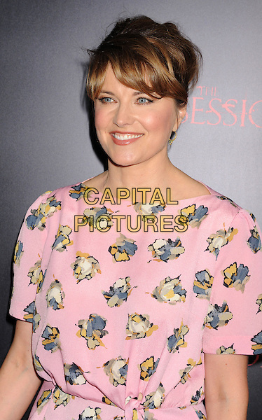 "Lucy Lawless.""The Possession"" Los Angeles Premiere held at Arclight Cinemas, Hollywood, California, USA..August 28th, 2012.half length dress blue pink blue yellow print .CAP/ROT/TM.©Tony Michaels/Roth Stock/Capital Pictures"