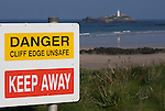 Warning signs along the cliffs at Godrevy, Cornwall