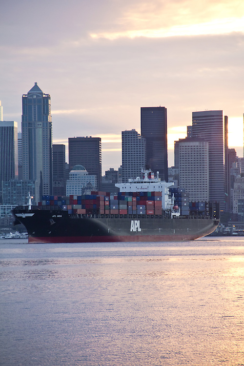Seattle, container shipping, APL India, Neptune Orient Lines, Crowley tugs, departing Port of Seattle at sunrise,  Puget Sound,