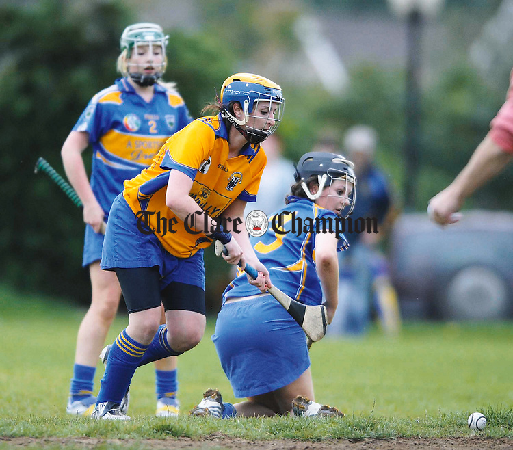Clare's Sinead Touhy scores a goal as Sile Ryan and Moira Ryan of Tipperary look on during the U-16 Munster Camogie final at Monaleen, Limerick. Photograph by John Kelly.