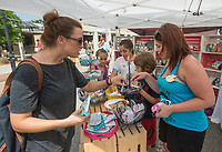 NWA Democrat-Gazette/BEN GOFF @NWABENGOFF<br /> Adrianne McGinnis (from left) of Springdale, daughter Meadow McGinnis, 10, friend Lucia Guzman-Barron, 12, of Rogers, and son Blaze McGinnis, 8, shop the Sewing with Squeak booth with owner Angela Bullard of Yukon, Okla.  Saturday, May 12, 2018, during The Little Craft Show in downtown Springdale.