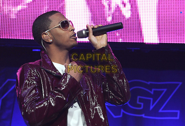 "TREY SONGZ.opens for Usher during his ""OMG Tour 2010"" at Honda Center in Anaheim, California, USA, November 14th, 2010..music concert live on stage gig half  length red shiny pvc jacket sunglasses white microphone singing hand      side profile     .CAP/RKE/DVS.©DVS/RockinExposures/Capital Pictures."