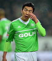 FUSSBALL   1. BUNDESLIGA   SAISON 2012/2013    22. SPIELTAG VfL Wolfsburg - FC Bayern Muenchen                       15.02.2013 Makoto Hasebe (VfL Wolfsburg) ist enttaeuscht